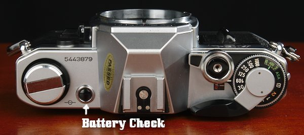 Battery Check on top plate near film rewind