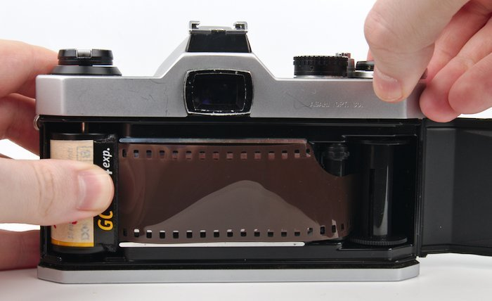 Hold Film Canister and Advance the Film