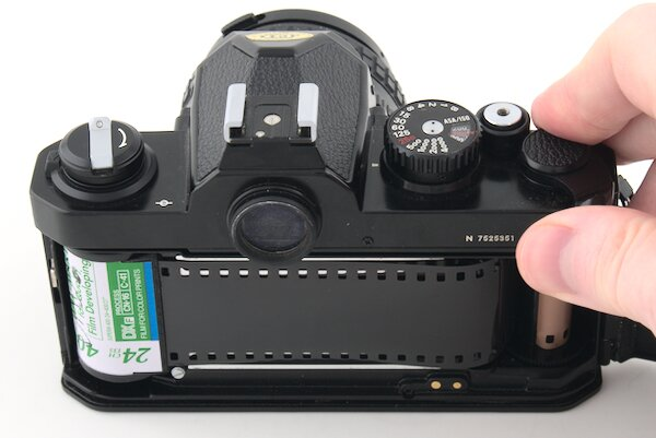 Advance the film and fire the shutter on the Nikon FM2