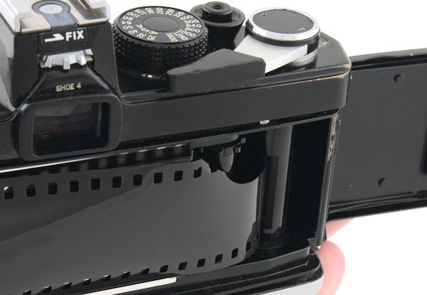 Insert the film leader into the Olympus OM-1 take-up spool